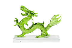 Glass green dragon isolated on white background. Glass green traditional chinese dragon isolated on white background. Feng Shui statuette Stock Photo