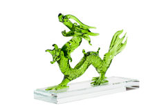 Glass green dragon isolated on white background. Glass green traditional chinese dragon isolated on white background. Feng Shui statuette Stock Image