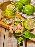 Glass with green Healthy lime drink and ginger . Stock Photos