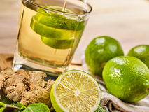 Glass with green Healthy lime drink and ginger . Stock Images