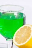 The glass of green lemonade and lemon Stock Photos