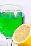 The glass of green lemonade and lemon Stock Photos