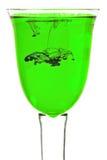 Glass of green liquid Stock Photo