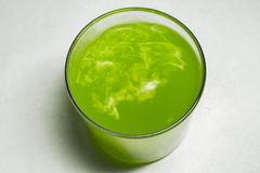 Glass with green liquid Royalty Free Stock Images