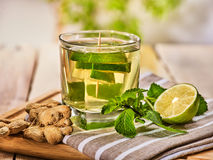 Glass with green mint lime drink and ginger . Royalty Free Stock Photo