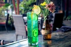 Glass of green refreshing lemonade with lime on top. Bali island. Stock Photos