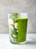 Glass of green smoothie Stock Image