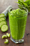 Glass of green smoothie Royalty Free Stock Photography