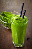 Glass of green smoothie Stock Images