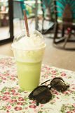 Glass of green tea latte frappe Stock Photography