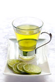 Glass of Green Tea with Lime. Slices. full of antioxidants and vitamin c stock image