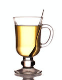 Glass of green tea with spoon Stock Photos
