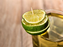 Glass with green transparent drink decoration of lime. Royalty Free Stock Image