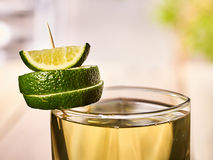 Glass with green transparent drink and lime. Stock Image