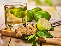 Glass with green transparent lime drink and ginger . Stock Image