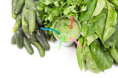 Glass of green vegetable juice. And green vegetables on the background Stock Photo