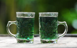 Glass with green water Royalty Free Stock Images