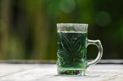 Glass with green water stock images