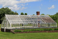 Glass greenhouse in full sun Stock Photos