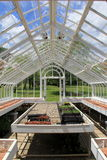 Glass greenhouse invites sunshine all day Stock Photography