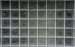 Glass grid wall. A wall in a building made from glass blocks stock images