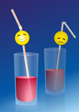 Glass half full half empty. Half full glass with a happy smiley on a straw, and a half empty glass with a sad smiley, a metaphor for positive and negative Royalty Free Stock Photos