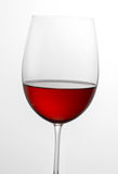 Glass half full of red wine Royalty Free Stock Photo