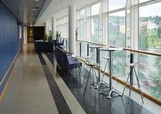 Glass hallway facing a town. Stock Photos