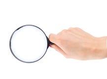 glass hand isolerad förstoring Arkivfoto