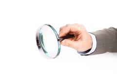 glass hand som förstorar Fotografering för Bildbyråer