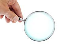 glass hand som förstorar Arkivfoto