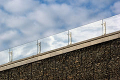 Glass handrails on a roof.  Royalty Free Stock Image