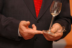 Glass in hands. Manager of firm with glass of white wine speaking royalty free stock images