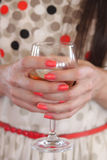 A glass in the hands of the girl  - Party People Stock Image