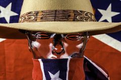 Glass Head. Wearing cowboy hat and rebel scarf with confederate flag background Stock Image