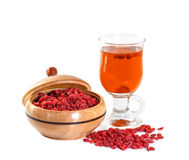 Glass healing infusion of goji berries Stock Photos