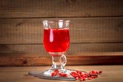 Glass healing infusion of goji berries Stock Photo