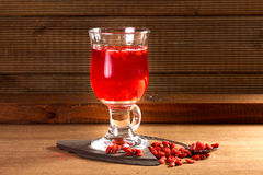 Glass healing infusion of goji berries Royalty Free Stock Photos
