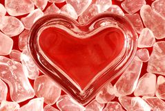 Glass heart. With ice over red background Royalty Free Stock Images