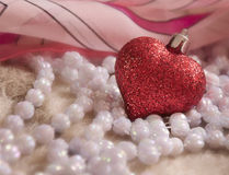 Glass heart and beads Royalty Free Stock Photography