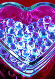 Glass Heart Box Filled with Glass Balls Royalty Free Stock Photo