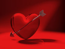 Glass heart and cupid arrow on red Stock Photos