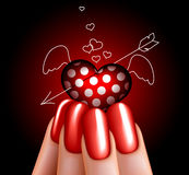 Glass heart in hand. Glass angel heart in hand. manicure. glamour Royalty Free Stock Image