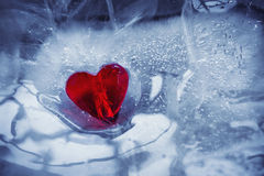 Glass heart and ice Stock Images