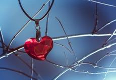 Glass heart pendant Stock Photo