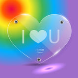 Glass heart on a rainbow background. Flat glass with glare. Love.  Flat glass with glare. Love. symbol of love Stock Images
