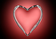 Glass heart. On red background Stock Photos