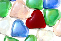 Glass Hearts. Assorted glass hearts on white background royalty free stock photos