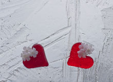 Glass hearts. Red valentine day glass hearts frozen in ice Royalty Free Stock Images