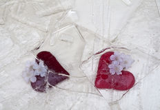 Glass hearts in broken ice Stock Photo